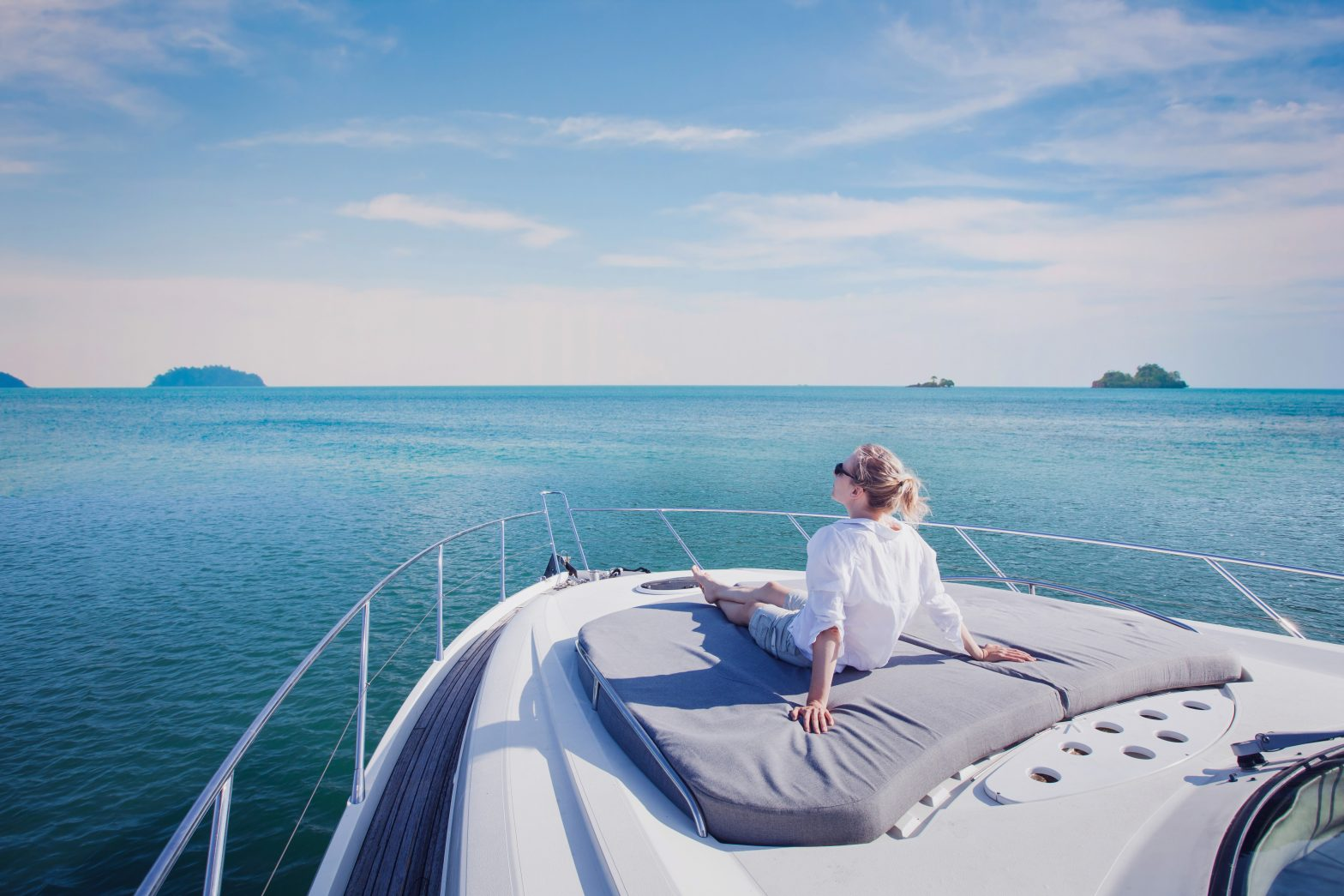 Woman Relaxing on the deck of a luxury boat