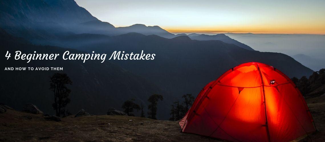 orange tent overlooking mountains at sunrise