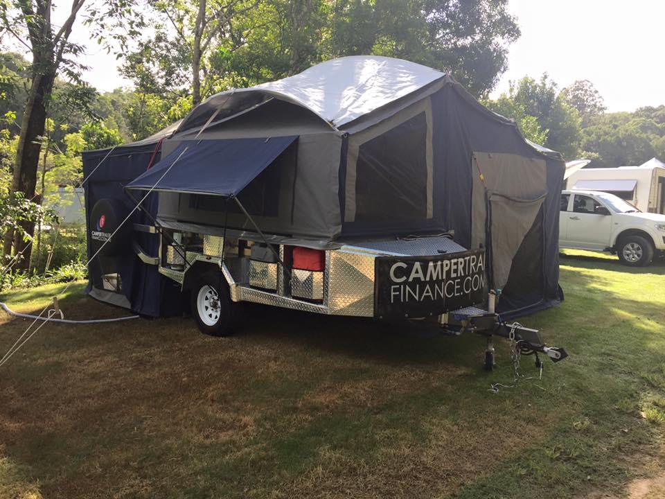Camper trailer set up at a campsite
