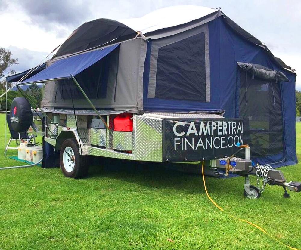 Camper trailer set up at a camp site.